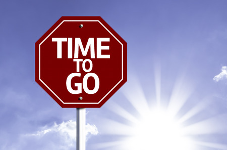 end times: Time To Go written on the road sign Stock Photo