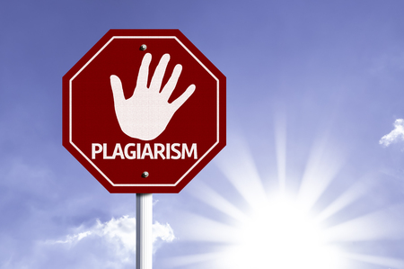 plagiarism: Plagiarism written on the road sign Stock Photo