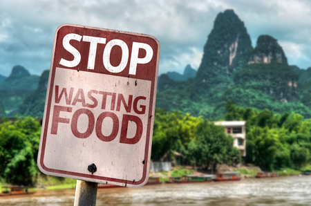 Stop Wasting Food sign with wetland background