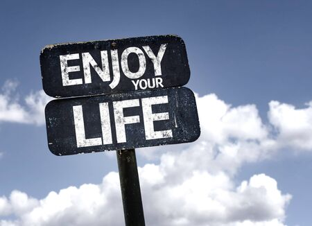 enjoy life: Enjoy Life sign with clouds and sky background Stock Photo