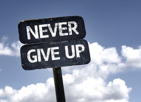 give up: Never Give Up sign with clouds and sky background