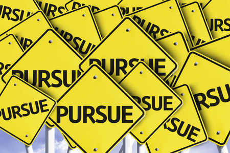 pursue: Multiple road signs with text: Pursue