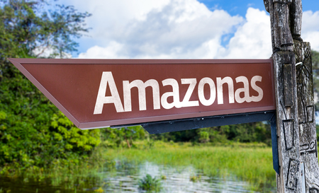 amazonas: Wooden sign board in wetland with text: Amazonas