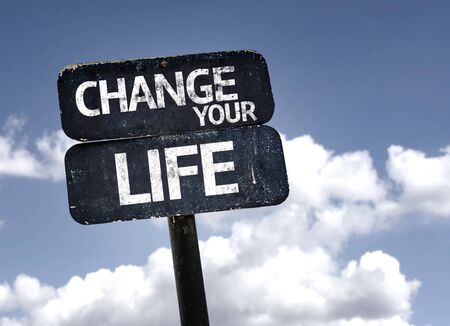 living wisdom: Change Your Life sign with clouds and sky background Stock Photo