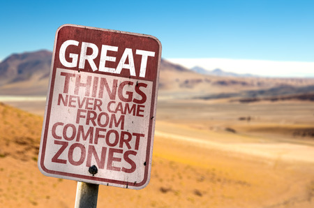 Great Things Never Came From Comfort Zones sign with desert background Banco de Imagens