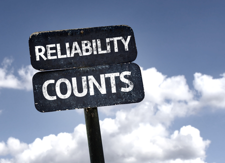 Reliability Counts sign with clouds and sky background