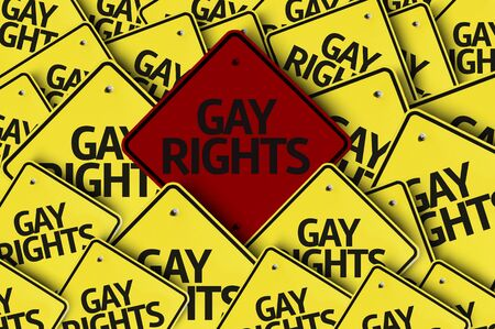 transexual: Una se�al de tr�fico roja entre las m�ltiples se�ales de tr�fico con el texto: derechos de los homosexuales Foto de archivo
