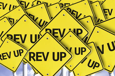 rev: Multiple road signs with text: Rev Up