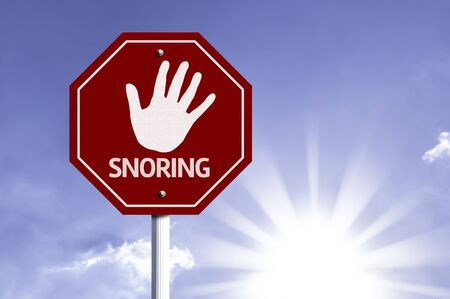 anti noise: Snoring written on the road sign Stock Photo