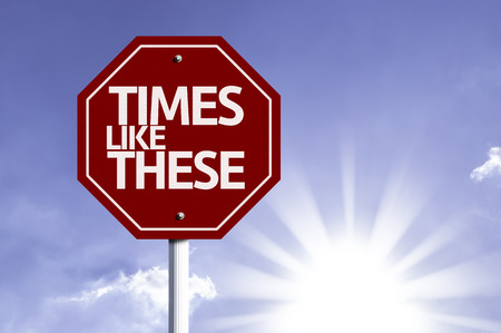 time's: Times Like These written on the road sign Stock Photo