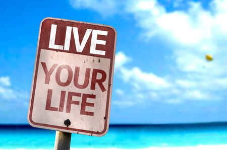 fulfilled: Live Your Life written on the road sign with sea background Stock Photo