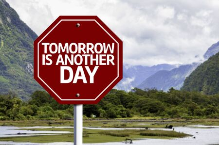 another: Tomorrow Is Another Day written on the road sign in a valley