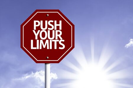 exceed: Push Your Limits written on the road sign Stock Photo