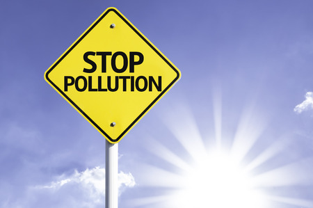 stop pollution: Stop pollution sign with sunny background Stock Photo