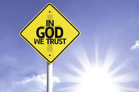 in god we trust: In God we trust sign with sunny background Stock Photo