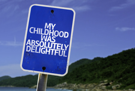 delightful: My childhood was absolutely delightful sign with beach background