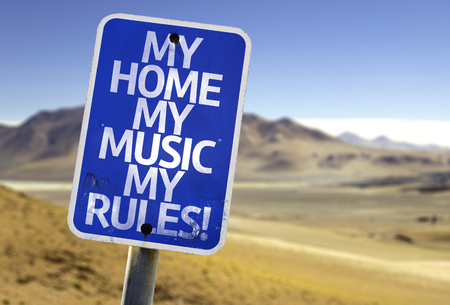 dissatisfaction: My home my music my rules! sign with desert background