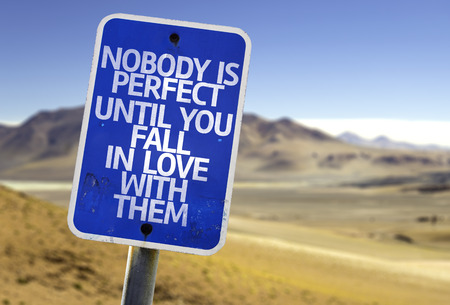 caes: Nobody is perfect until you fall in love with them sign with desert background