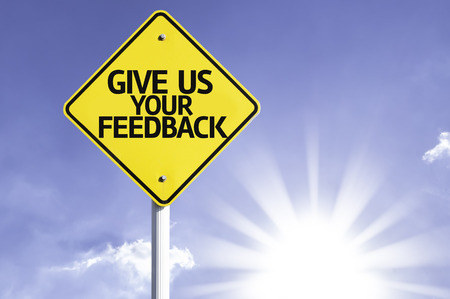 commenting: Give us your feedback sign with sunny background