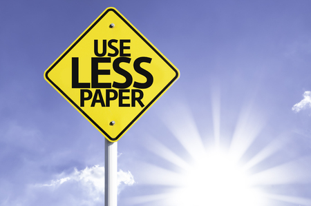 less: Use less paper sign with sunny background