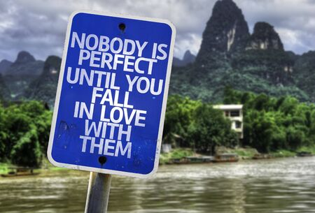 caes: Nobody is perfect until you fall in love with them sign with wetland background