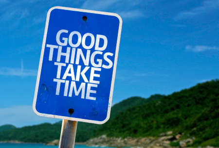 virtue: Good things take time sign with beach background