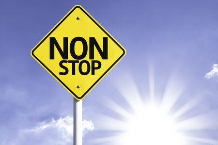 availability: Non stop sign with sunny background Stock Photo