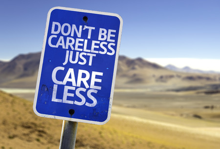 careless: Dont be careless just care less sign with desert background