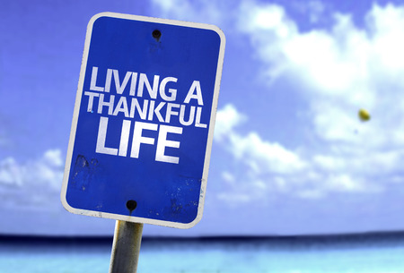 acknowledgment: Living a thankful life sign with sea background