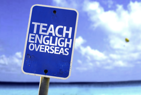 oportunity: Teach English overseas sign with sea background Stock Photo