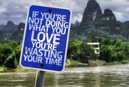 what if: If youre not doing what you love youre wasting time sign with wetland background