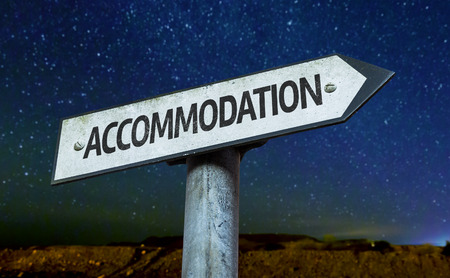 accommodation: Accommodation sign with night sky background Stock Photo