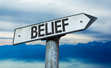 christian trust: Belief sign with sky background