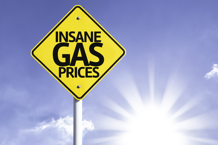 gas prices: Insane gas prices sign with sunny background