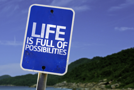 possibilities: Life is full of possibilities sign with beach background