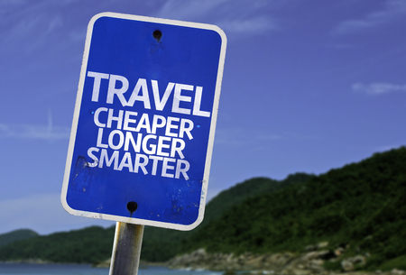 cheaper: Travel cheaper longer smarter sign with beach background