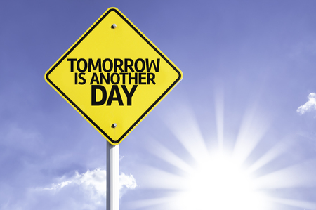 tomorrow: Tomorrow is another day sign with sunny background