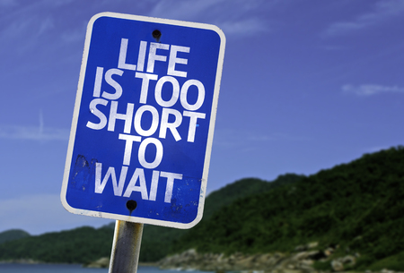 wait sign: Life is too short to wait sign with beach background