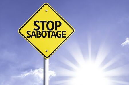 sabotage: Stop sabotage sign with sunny background