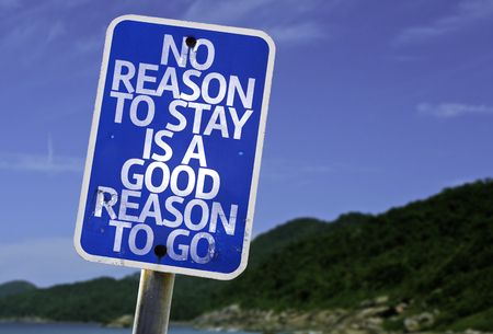 reason: No reason to stay is a good reason to go sign with beach background Stock Photo