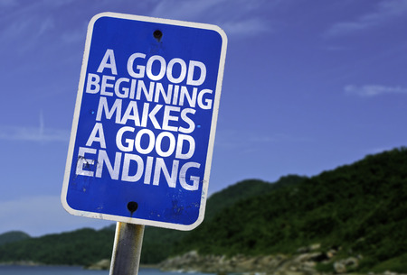 ending: A good beginning makes a good ending sign with beach background Stock Photo