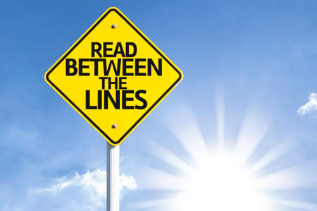 explicitly: Read between the lines sign with sunny background