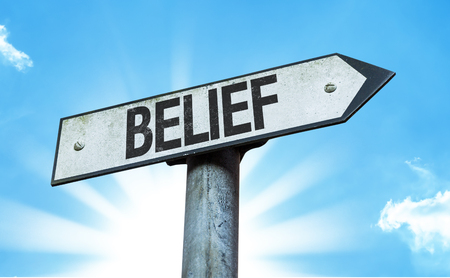 christian trust: Belief sign with sunny background Stock Photo