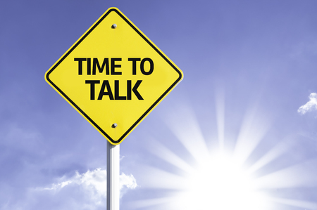communicative: Time to talk sign with sunny background
