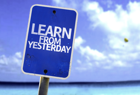 yesterday: Learn from yesterday sign with sea background Stock Photo