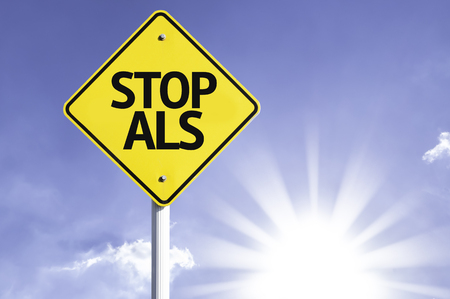 Stop ALS sign with sunny background Stock Photo