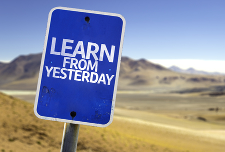 yesterday: Learn from yesterday sign with desert background Stock Photo