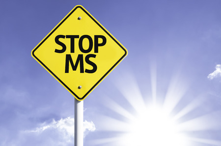 spasms: Stop MS sign with sunny background