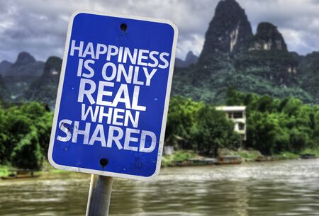 Happiness is only real when shared sign with wetland background