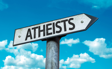 atheism: Atheists sign with clouds and sky background Stock Photo